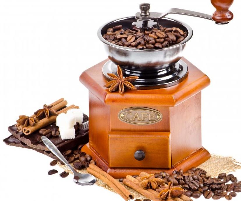Старомодная кофемолка с ручным приводом.