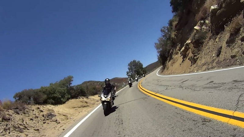 Cyclist joins then overtakes motorcycles