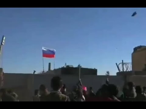 Kurds throw stones at Russian military base in Ain Issa, Syria
